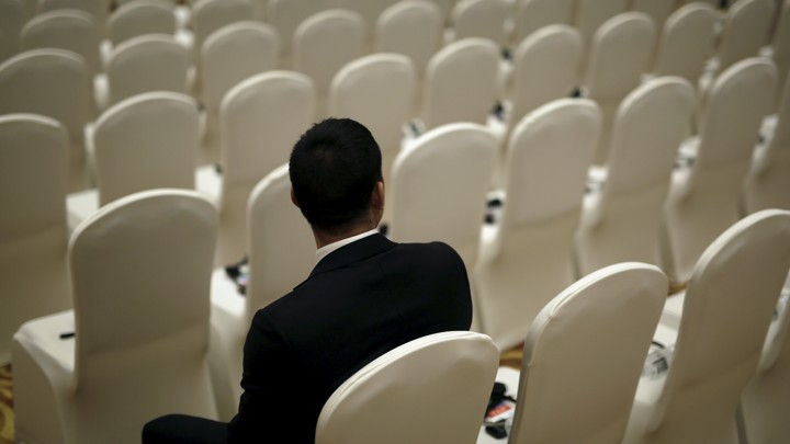 A security guard sits on a chair before the opening ceremony of the 2nd World Internet Conference in Wuzhen town of Jiaxing, Zhejiang province, China, December 16, 2015. REUTERS/Aly Song - RTX1YV2W